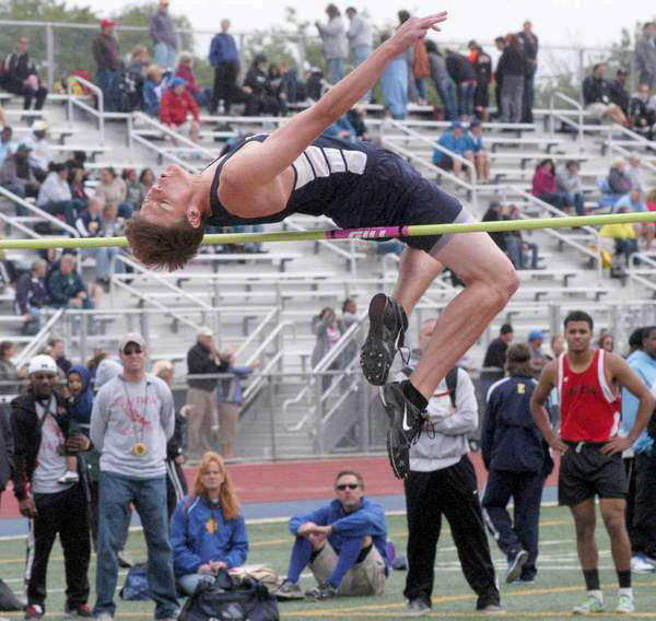 Petoskey's Louis Lamberti arches over the bar in his final attempt at 6 feet, 8 inches, Saturday to win the Division II state high jump title at Houseman Field in Grand Rapids. At right (in red) is Demarcus Leak of Paw Paw, who finished second. Lamberti, a 6-foot-2 junior, became the first Petoskey boy to win an event in the state finals since 2001. The 6-8 leap tied Lamberti for the best in the state finals, regardless of division.