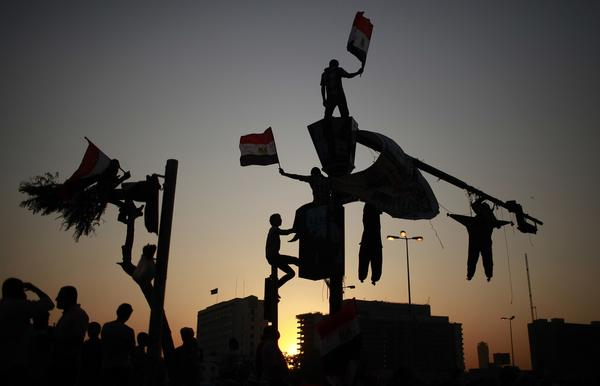 Protesters wave Egypt's flags during a demonstration at Tahrir square in Cairo, against the verdict for deposed leader Hosni Mubarak June 4, 2012. Egyptian pro-democracy campaigners called on Sunday for a new uprising.