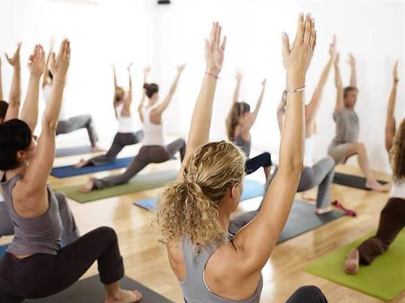 People participate in a YogaWorks class in Santa Monica, California