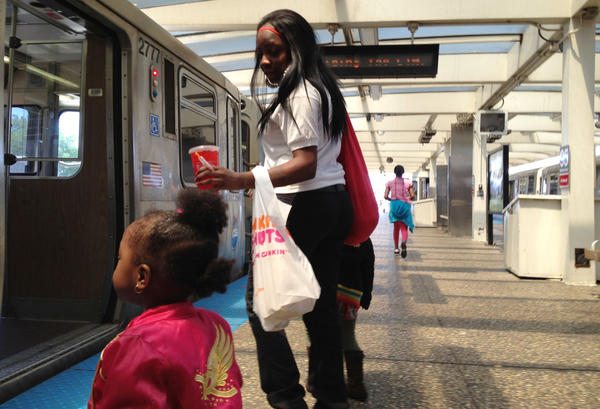 Conchetta Davis boards the northbound Red Line train at 95th today. The south branch of the CTA Red Line will close for five months starting in spring 2013 so a $425 million track replacement project can be completed more quickly, officials said.