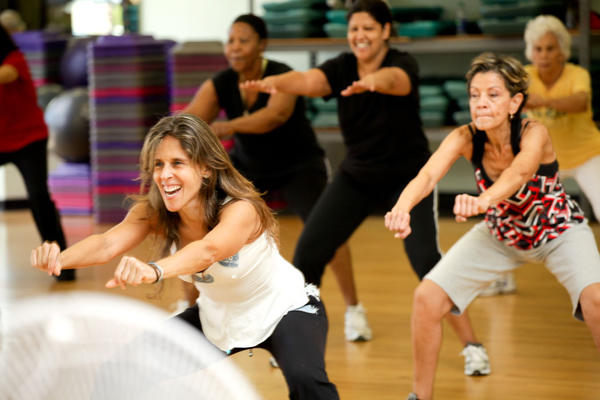 "Isabel Maldanado, front, teaches Zumba during ""National Senior Health and Fitness Day,"" which took place on May 30 at the David Posnack Jewish Community Center (JCC) located in Davie. The JCC offered free fitness activities and lectures as part of a nationwide celebration with more than 1,000 locations and 100,000 seniors participating throughout the U.S."