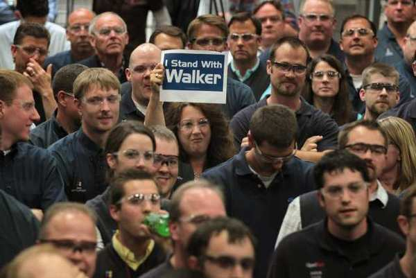 A worker at Quad Graphics shows her support during a campaign stop by Wisconsin Governor Scott Walker in Sussex, Wisconsin. Walker faces Democratic contender Milwaukee Mayor Tom Barrett in a recall election on June 5.