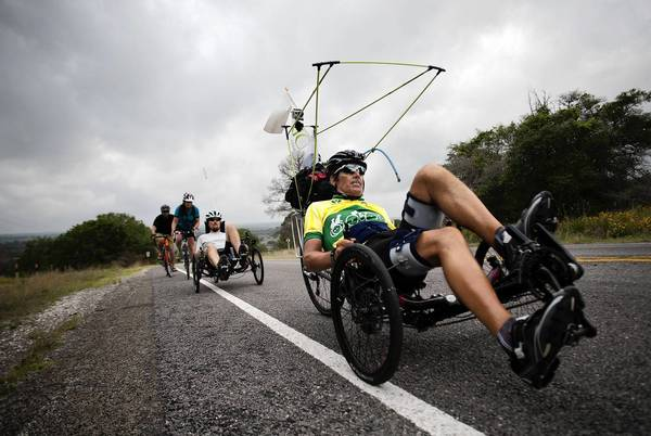 Mark Stephan, of Winnetka, leads the pack on his recumbent tricycle as his team pedals through Texas last week.