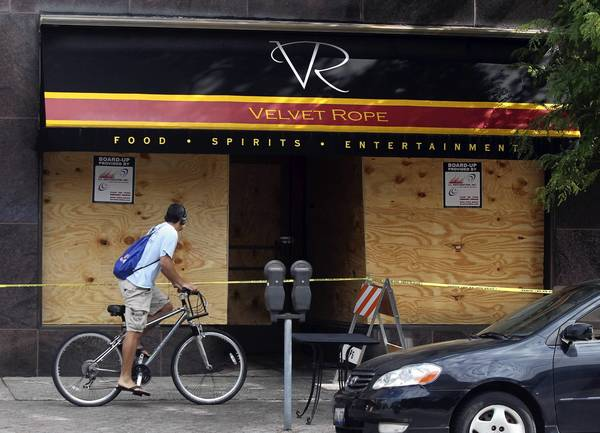 The windows were boarded up Monday at the Velvet Rope in Oak Park after a fire Sunday gutted the club.
