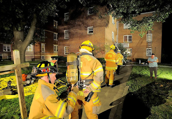 Fire crews work at the scene of an apartment fire Monday night on Hamilton Boulevard in Hagerstown's North End.