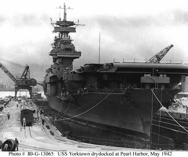 Official U.S. Navy Photograph, U.S. National Archives collection The Yorktown receives urgent repairs for damage received in the Battle of Coral Sea in Dry Dock No. 1 at the Pearl Harbor Navy Yard, on May 29, 1942. The carrier left Pearl Harbor the next day to participate in the Battle of Midway.