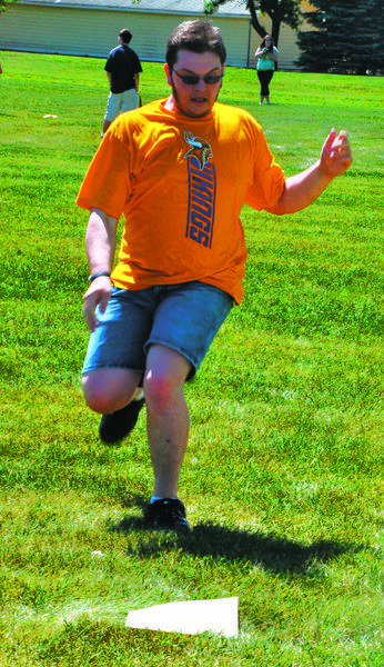Troy Winge of Wilmot heads into third base in a kickball game Monday during Upward Bound, a Northern State University educational program. The program serves first-generation college students as well as low-income ones.