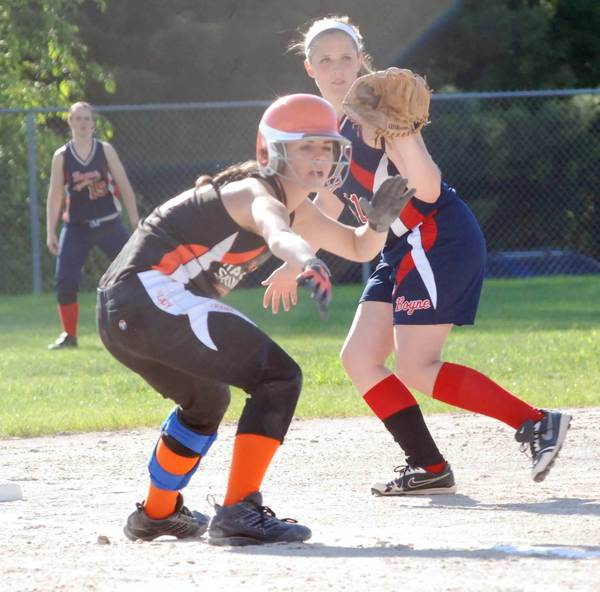 Tessa Groleske (left) of Harbor Springs takes a lead off third base as Boyne City's Ketrin Hocquard covers the base during Monday's Division III district semifinal at the East Jordan High School.