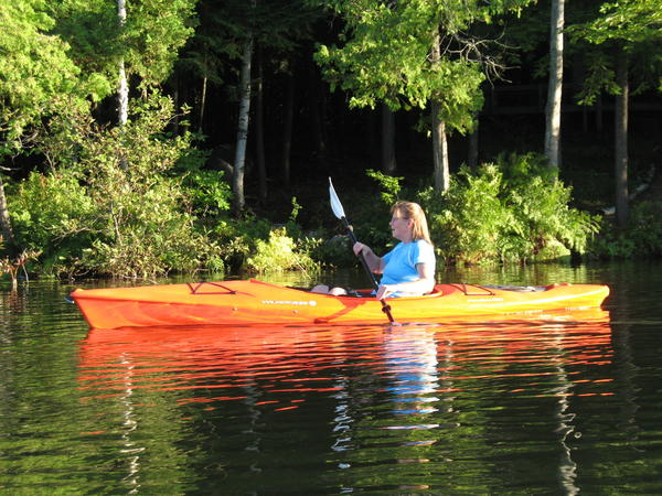 Carole Cantrell tours Munro Lake in her kayak. A meeting is scheduled on Wednesday, June 6, at the Petoskey Friendship Center to discuss the formation of a kayak outing group for mature paddlers.