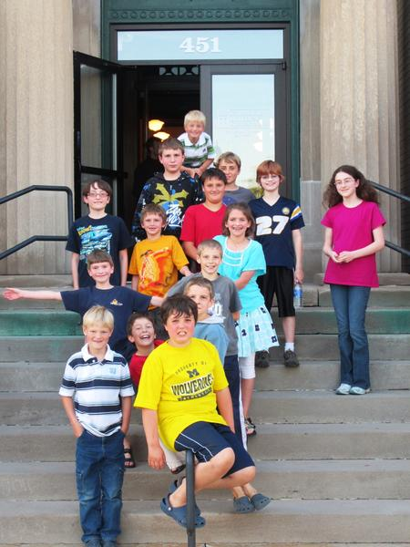 Participants in the Petoskey District Library's Chess Gang gather at the final family chess night of the season at the Carnegie building, (from top, by row, from left) Derk Boerman; Tyler Pars, Sean McCloskey; Alex Bemben, Aiden Tanis, Christian Duran, Landon Brantly, Ceara Struck; Hailey Tanis; Joel Struck, Caleb Dubey; Klaas Boerman, Gabriel Kruger, Joel Dubey; John McCloskey.