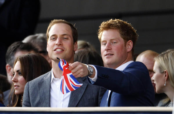 Britain's Prince Harry waves a Union Flag as he watches with Prince William and Catherine, Duchess of Cambridge during the Diamond Jubilee concert in front of Buckingham Palace in London.