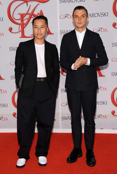 The 2012 CFDA awards red carpet: Designer Phillip Lim, left, and guest.