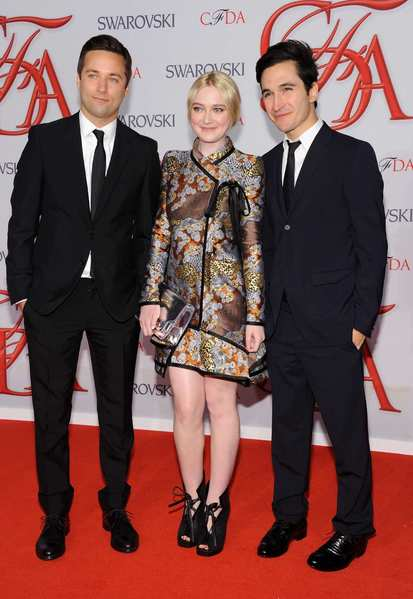The 2012 CFDA awards red carpet: Actress Dakota Fanning with Jack McCollough, left, and Lazaro Hernandez of Proenza Schouler.