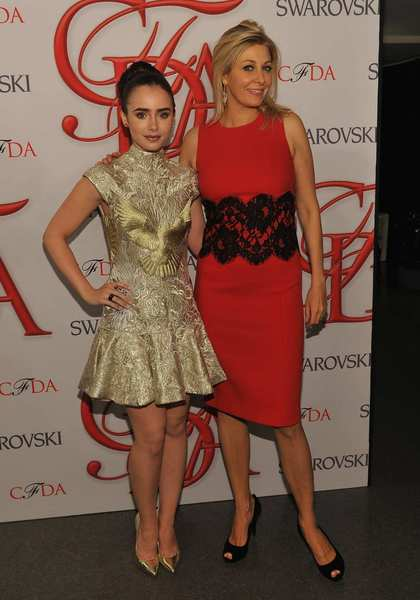 The 2012 CFDA awards red carpet: From left, Lily Collins in a Marchesa dress and Swarovski jewelry and Nadja Swarovski.