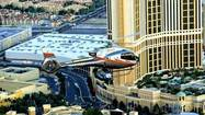 A Maverick ECO-Star helicopter soars high above the Strip