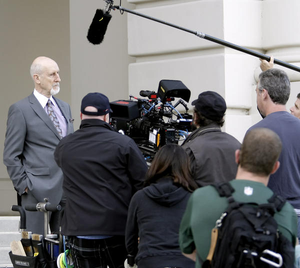 "Actor James Cromwell, left, shoots a scene for the film ""The Trials of Cate McCall"" in front of Pasadena City Hall on Tuesday, June 5, 2012."