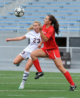 Whitehall's Kayla Cunningham (23) battles for the ball  against  Red Land's Erin Dziedzina (13) during a girls high school soccer game in PIAA semifinals at Hersheypark Stadium on Tuesday afternoon. Whitehall wins 5-3 over Red Land.