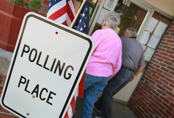 Voters arrive at a polling site in Clinton on Tuesday to cast ballots in Wisconsin's recall election. Milwaukee Mayor Tom Barrett, a Democrat, is trying to unseat Republican Gov. Scott Walker in the recall vote. Opponents of Walker forced a recall election after the governor pushed to change the collective bargaining process for public employees in the state.