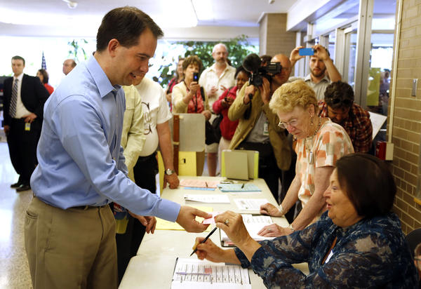 Wisconsin Gov. Scott Walker prepares to cast his ballot in Wauwatosa, Wis.