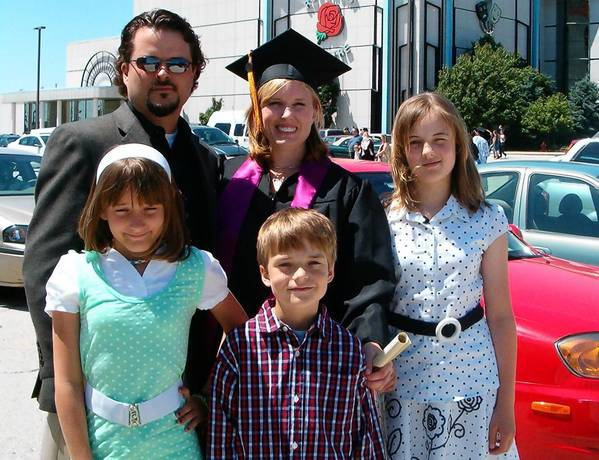 Kimberly Vaughn, 34, center, with husband Christopher, left, and their children, from lower left, Cassandra, 11; Blake, 8; and Abigayle, 12, on Kimberly's graduation day from from University of Phoenix. Kimberly and the children were found shot to death less than a week later.
