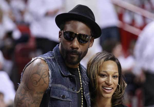 New York Knicks' player Amare Stoudemire stands with his new fiancee, Alexis Welch courtside before the Miami Heat met the Boston Celtics during Game 5 of their Eastern Conference Finals NBA basketball playoffs in Miami, Florida June 5, 2012.