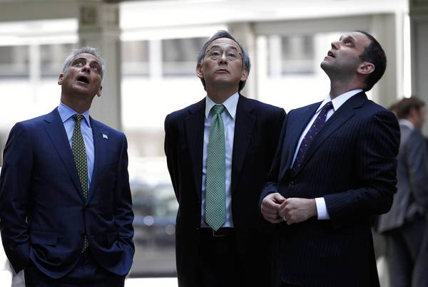 Chicago Mayor Rahm Emanuel, from left, U.S. Energy Secretary Steven Chu and Ari Glass, senior vice president of Zeller Realty Group, take a look at the Wrigley Building before a Tuesday news conference on a city energy efficiency effort. Emanuel on Tuesday backed a CTA plan to close the south branch of the Red Line for five months during reconstruction work.