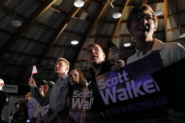 Supporters of Wisconsin Gov. Scott Walker rally in Waukesha as they await election results.