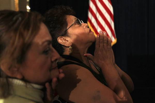 Guadalupe Gallardo of Milwaukee prays as she awaits results while attending Wisconsin Democratic Gubernatorial Recall Election candidate Tom Barrett's election night gathering in Milwaukee.