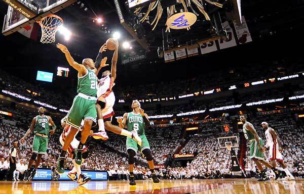 Miami's Norris Cole attacks the paint as Boston's Ray Allen defends.