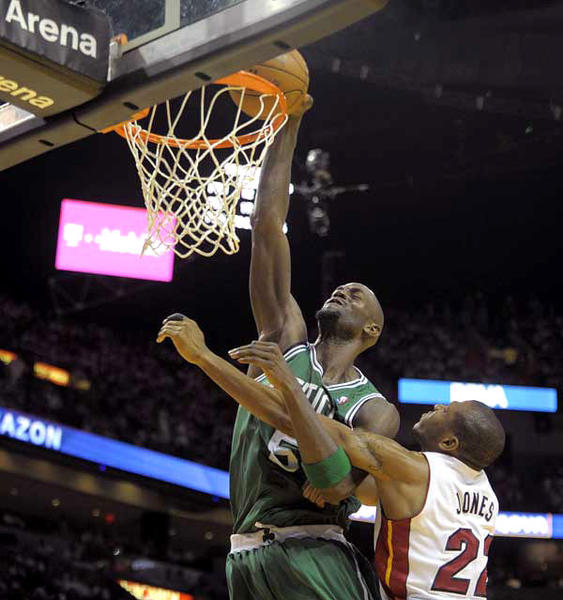 Boston Celtics forward Kevin Garnett dunks the ball while being fouled by Miami Heat forward James Jones during the third quarter of Game 5, Tuesday, June 5, 2012, at AmericanAirlines Arena.