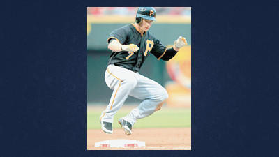 Pittsburgh Pirates' Alex Presley hops onto third base after hitting a triple in the third inning of a baseball game against the Cincinnati Reds Tuesday in Cincinnati.