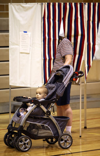 Thirteen-month-old Charles Smilloff waited patiently while his mother Heidi Smilloff voted at Precinct 002 Tuesday at the Washington Street Gym. photo by john davis taken 6/5/2012