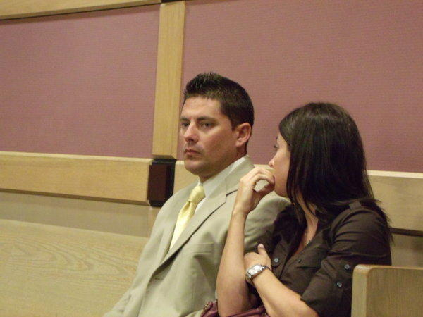 Former Broward Sheriff's Deputy Brent Wooddell, with his wife, attended a court hearing May 25 in front of Broward Circuit Judge Carlos Rebollo.