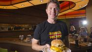 Bobby Flay was in Hanover on Wednesday afternoon, presiding over last-minute preparations for hist tenth Bobby's Burger Palace, set to open Wednesday ngiht, at the new Maryland Live Casino. Flanking the casino's main entrance, the new BBP is the largest in the chain and the first to feature outdoor seating.
