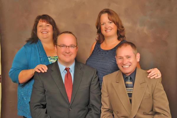 The Powell Team: front row, Steven L. Powell, left, and Steve Souders; back row, Stephenie Rinehart, left, and Linda Hansen.