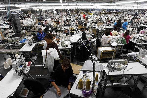 Some of the workers in American Apparel's facility in South Gate prepare garments.