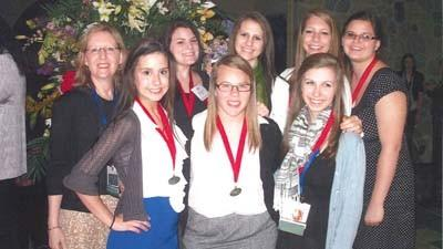 Members of Petoskey High Schools affiliate of Family, Career and Community Leaders of America are shown at a recent state conference in Midland. They include (front row, from left) Maddison Reilly, Caitlin Strobel, Kaitlyn Gillis, (back row) adviser Barbara Kennedy, Suzanne Tyler, Bria Dalgliesh, Whitney Warner and Leah Stoner.