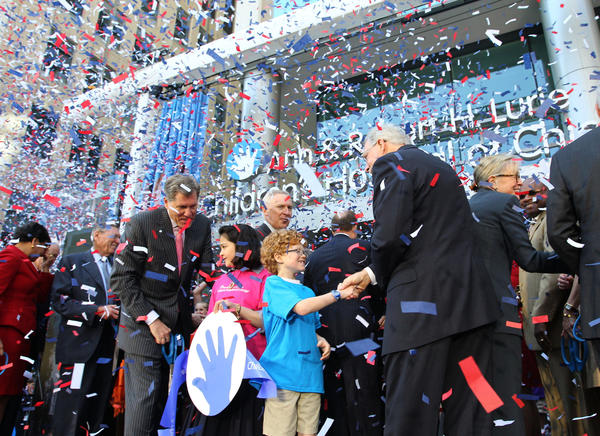 Children and dignitaries share the stage during the ribbon cutting ceremony for the Ann & Robert Lurie Children's Hospital of Chicago on Monday.