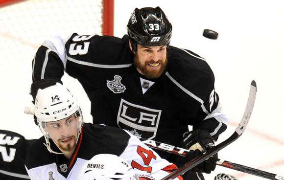 Willie Mitchell of the Kings battles for position with Adam Henrique of the Devils in Game 3.