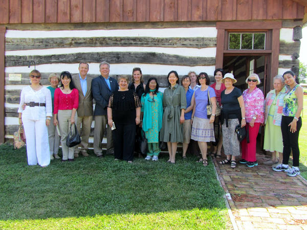 President and CEO of the Convention and Visitors Bureau Tom Riford, fourth from left, Washington County Commissioner Jeff Cline and diplomatic representatives from 10 countries that visit the Rural Heritage Museum.