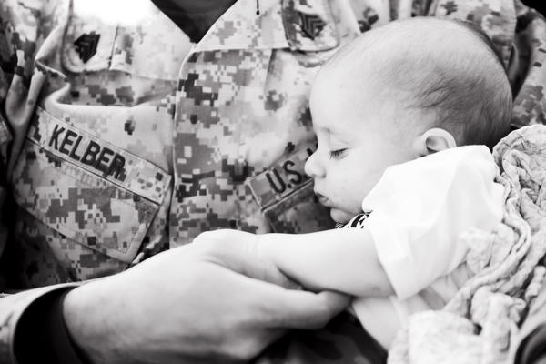 Sgt. Judah Kelber, just off the bus at Camp Lejeune, N.C., holds his son Aaron, just shy of 10 weeks old, just after meeting him for the first time after returning from a seven-month deployment to Afghanistan.