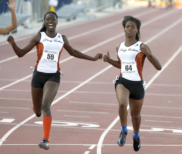 Boyd Anderson teammates Shayla Sanders and Kali Davis-White finish first and second in the 200 meter dash during the FHSAA Class 4A State Track and Field Finals at the University of North Florida. Their efforts helped the Boyd Anderson girls track team win its first state title.