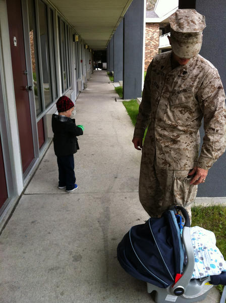 After arriving back in the U.S. after a seven-month deployment in Afghanistan, Marines from 4th Civil Affairs Group in D.C. had to spend several days doing outprocessing in Camp Lejeune, N.C. Here, Sgt. Judah Kelber jumps right back into family life, waiting to let both his sons into a room at the Lejeune Inn.