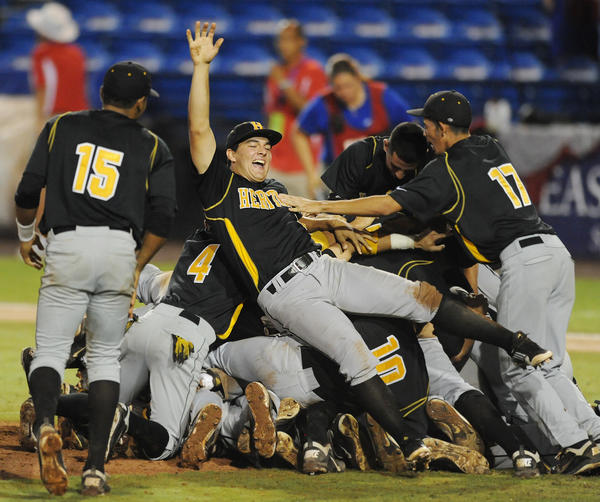 Members of the American Heritage baseball team celebrate after a 9-0 win over Ponte Vedra in the Class 5A state championship game. The Patriots are currently ranked No. 1 in the nation in the ESPNHS Powerade Fab 50 and could finish as national champions.