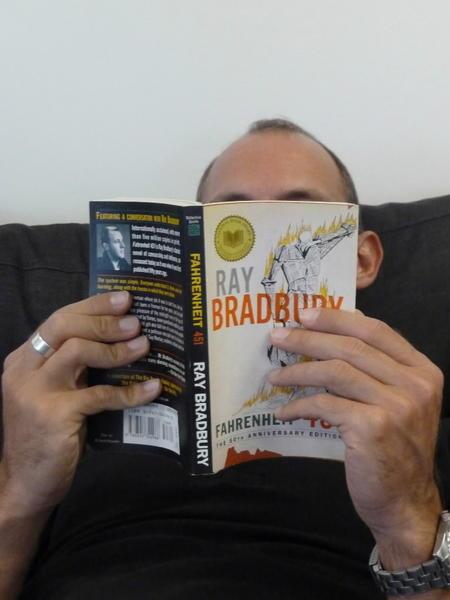 "This photo illustration shows a man reading Ray Bradbury's ""Farenheit 451"" in Los Angeles."