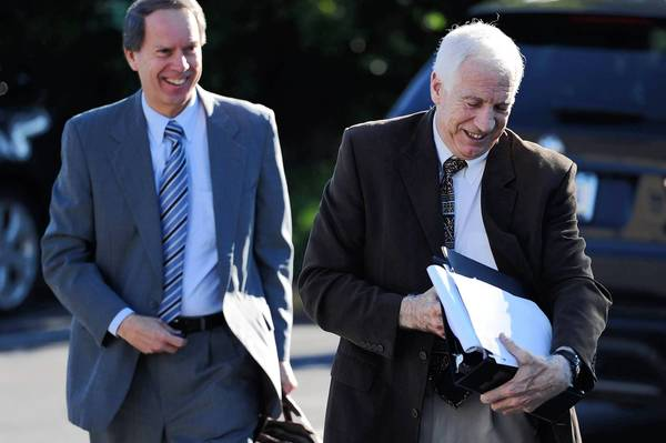 Former Penn State assistant football coach Jerry Sandusky, right, arrives at court with attorney Joe Amendola.