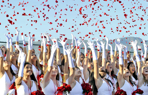 Graduates throw rose petals during the Flintridge Sacred Heart Academy Commencement on Sunday, June 3, 2012.