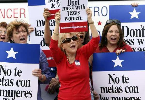 "Women in San Antonio rally in March during the ""Women's Health Express"" event held to protest a plan to cut Planned Parenthood from a Texas program serving uninsured, low-income women."