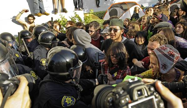 Police in riot gear clash with protesters in front of Sproul Hall at UC Berkeley on Nov. 9, 2011. The campus' chancellor asked for a review of officers' use of force.