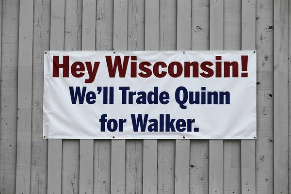 A sign, apparently posted by an unhappy Illinoisan, hangs from a building in South Beloit, Ill.